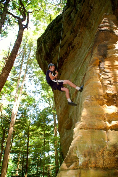 Caleb rock climbing