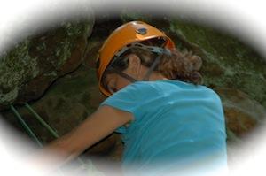 Stacy rock climbing