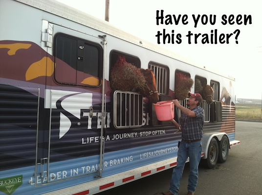 Jesse Westfall watering horses in horse trailer