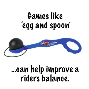 *One of Stacy's favorite training tools *Egg and spoon helps you work on focus while improving posture, seat position and balance. *Balancing the egg helps you focus on keeping your hands steady and improving your seat. *The tool has a blue handle with three interchangeable cups and an attached black ball. *The interchangeable cups come in three depths to offer varying levels of difficulty. *This tool is also great practice for egg and spoon events at horse shows.