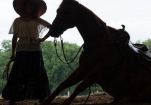 Stacy Westfall and Popcorn, horse sitting